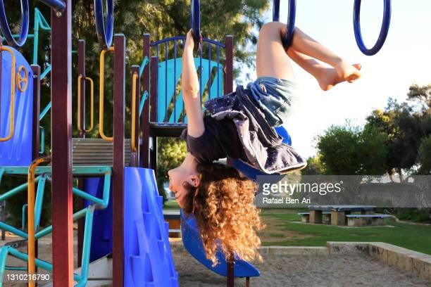 young australian girl playing  playground monkey bars - rafael ben ari stock pictures, royalty-free photos & images
