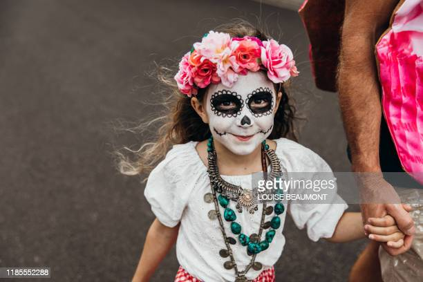 young australian girl trick or treating on halloween - day of the dead stock pictures, royalty-free photos & images