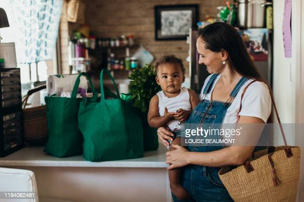 young australian mother and son - thisisaustralia stock pictures, royalty-free photos & images