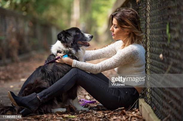 young australian woman walking dog - mental wellbeing stock pictures, royalty-free photos & images