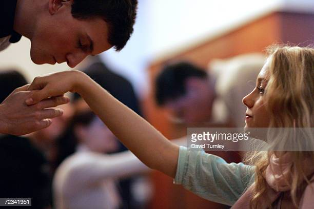 A young Austrian kisses the hand of his partner while learning how to waltz at the famous Elmayer School on March 18 2005 in Vienna Austria The...