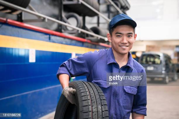 young auto mechanic at work - izusek stock pictures, royalty-free photos & images