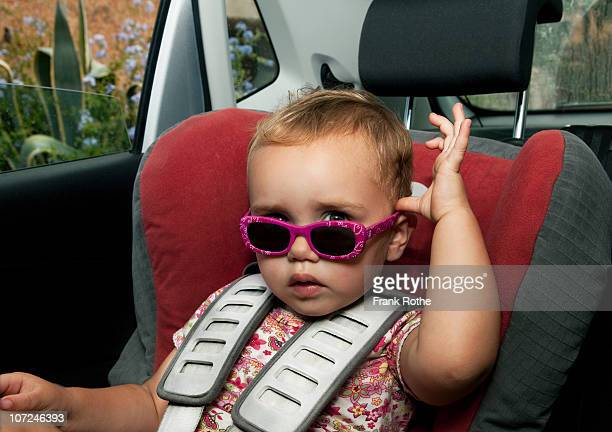 young baby girl gives a glance about here glasses