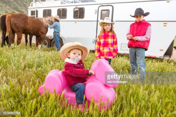 young baby girl playing at countryside of santaquin valley of salt lake city slc utah usa - spanish fork utah stock pictures, royalty-free photos & images