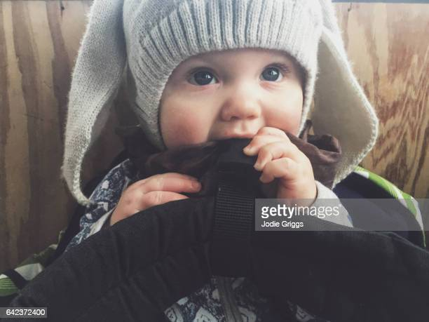 Young baby wearing warm hat with rabbit ears