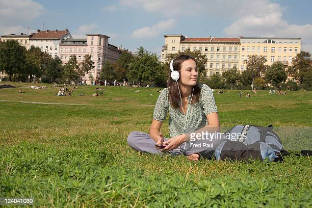 Young backpacker relaxing in a park