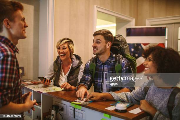 young backpackers in hostel - hostel stock pictures, royalty-free photos & images