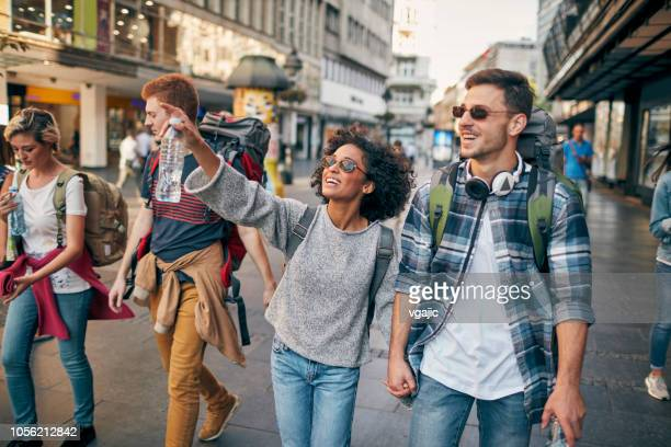 young backpackers in the city - tourist stock pictures, royalty-free photos & images