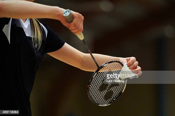 A young badminton player is about to make a serve during the Yonex Denmark Junior Youth Badminton Tournament in Paarup Hallen on October 17 2014 in...