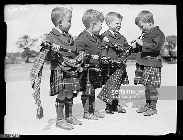 Young bagpipers 1933 A photograph of four young boys with bagpipes taken by Woodbine for the Daily Herald newspaper on 17 June 1933 The boys were...
