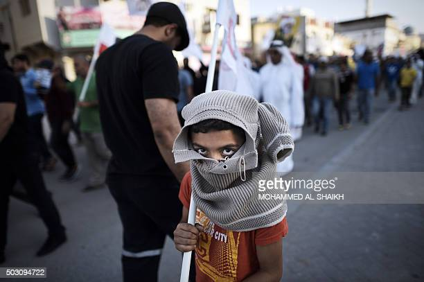 A young Bahraini boys poses for a picture during a demonstration against the government in the village of Sitra south of Manama on January 1 2016 AFP...