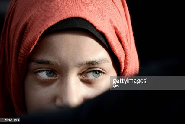 Young Bahraini girl attends an anti-government rally to support Bahraini top senior Shiite cleric, Sheikh Isa Qassim, in the village of Diraz, west...