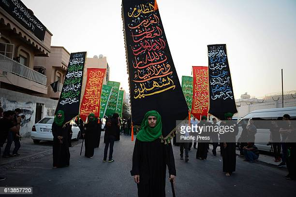 Young Bahrainis are organized in a historic carnival season Ashura in Sanabis village south of the Bahraini capital Manama Shi'a Muslims Yahya in...