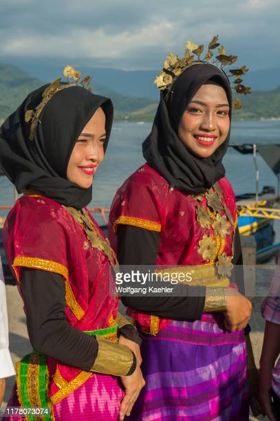 Young Bajau women at a traditional dance performance on Bungin Island, off the coast of Sumbawa Island, Indonesia, home to a group of Bajau Sea...