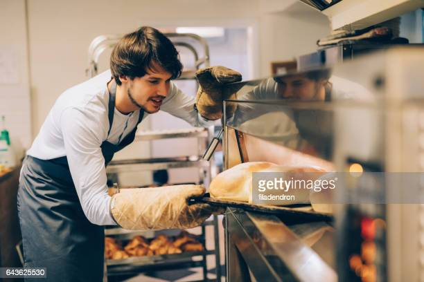 young baker - brown glove stock pictures, royalty-free photos & images