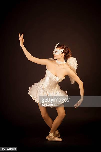 Young ballerina in angel costume and mask