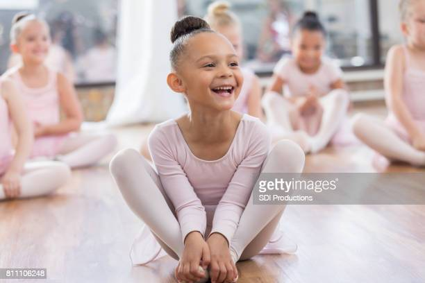 young ballerina laughs at instructor's joke - little girls dressed up wearing pantyhose stock photos and pictures