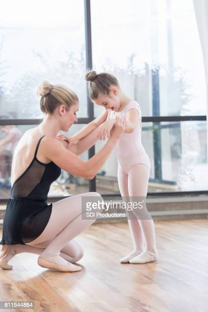 young ballerina learns dance steps - little girls dressed up wearing pantyhose stock photos and pictures
