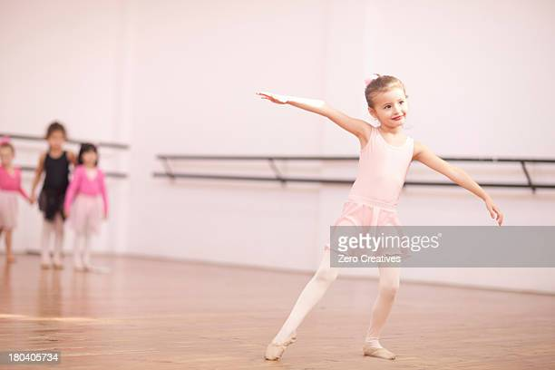 Young ballerina posing in class