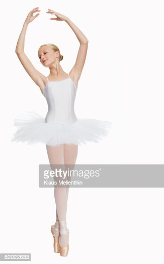 Young Ballerina Standing On Pointe In Toe Shoes Portrait ...