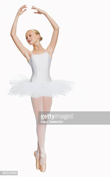 young ballerina (14-15) standing on pointe in toe shoes,, portrait - ballet dancer stock pictures, royalty-free photos & images