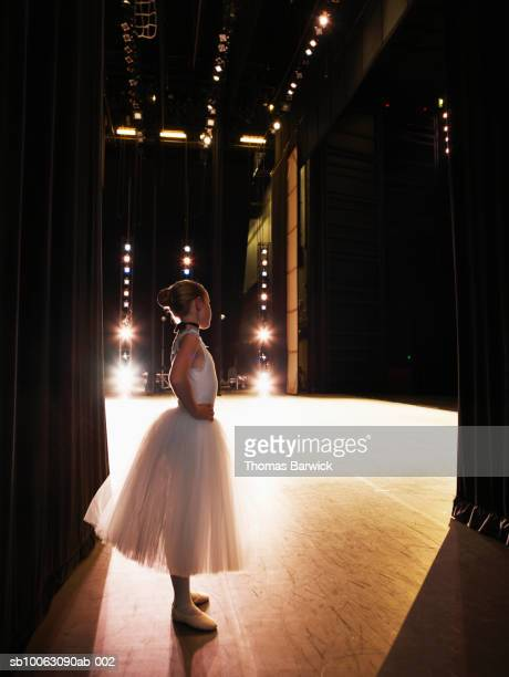 young ballerina waiting in wings - kulisse bühne stock-fotos und bilder
