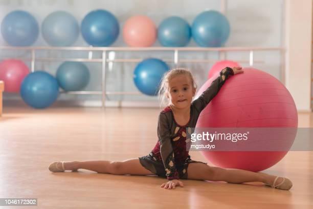 young ballerinas dancer doing practice in ballet studio. - school gymnastics stock photos and pictures