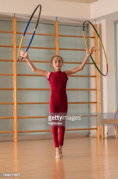young ballerinas dancer doing practice with hula in ballet studio. - arte, cultura e espetáculo imagens e fotografias de stock