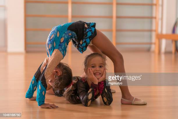 young ballerinas dancers doing practice in ballet studio. - rhythmic gymnastics stock pictures, royalty-free photos & images
