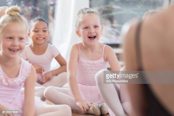 Young ballerinas laugh in class