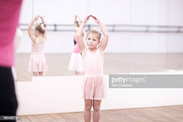 Young ballerinas posing in dance studio