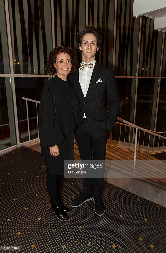 Young ballet dancer Andreas Kaas (R) arrives with his mother to the Alvin Ailey American Dance Theater performance in the Tivoli Concert Hall in Copenhagen on October 27, 2016 in Denmark. During the play Andreas Kaas will receive late Queen Margrethe's grant to young artists within dance and music. The other award winner is jazz singer Sinne Eeg. The award is to be presented by Queen Margrethe and her sisters Queen Anne-Marie of Grece and Princess Benedikte.