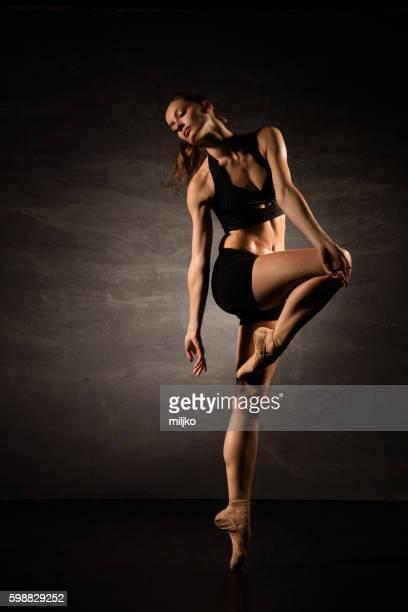 Young ballet dancer dancing in studio