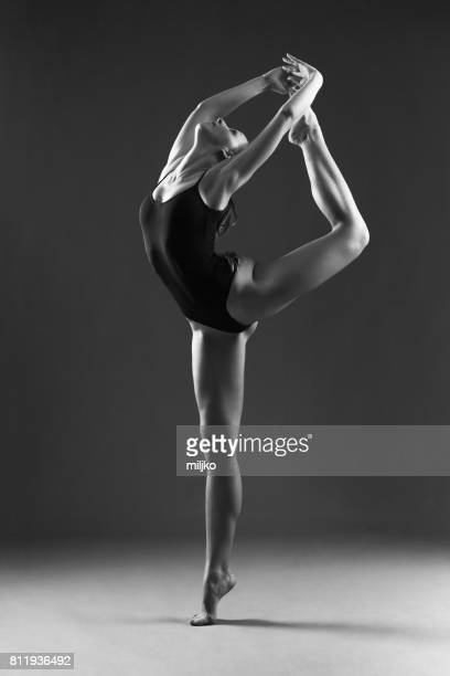 Young ballet dancer dancing in studio