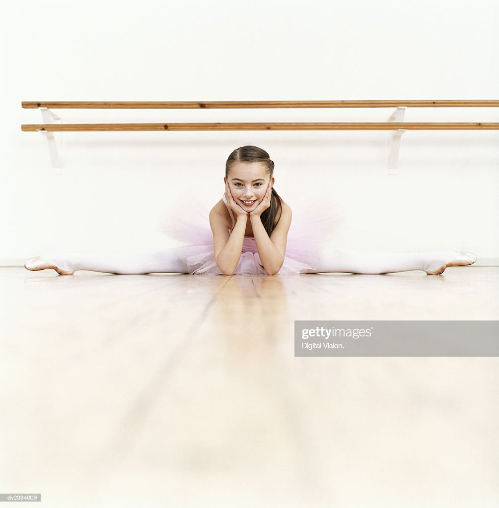 Young Ballet Dancer Doing the Splits in a Dance Studio : Stock Photo