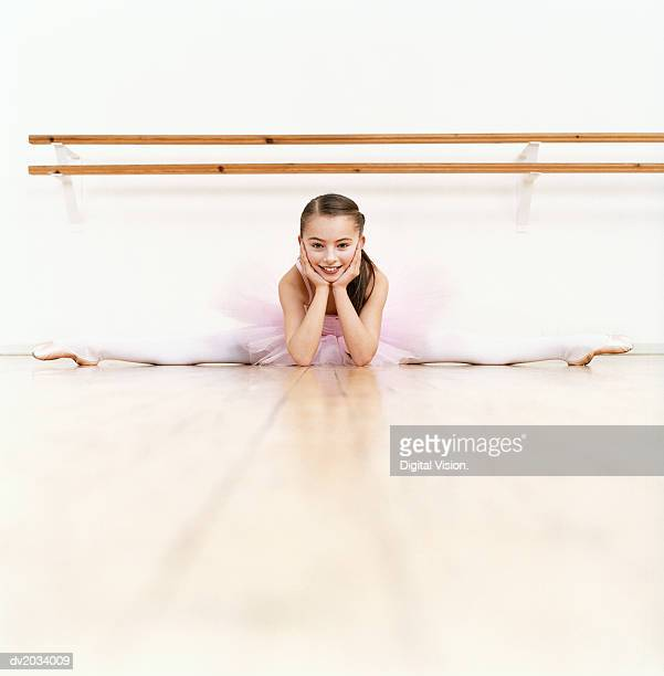 Young Ballet Dancer Doing the Splits in a Dance Studio