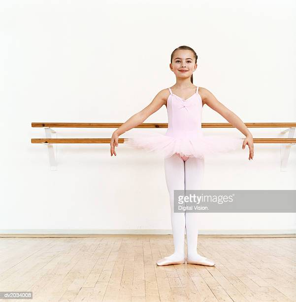 Young Ballet Dancer Practicing in a Dance Studio