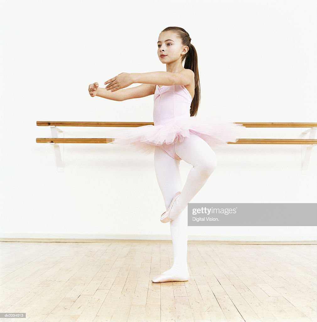 Young Ballet Dancer Practicing in a Dance Studio : Stock Photo