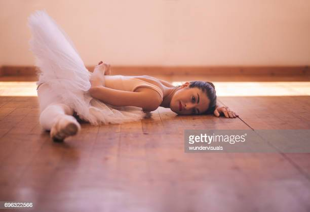 young ballet dancer with tutu doing a side split - teen girls toes stock photos and pictures