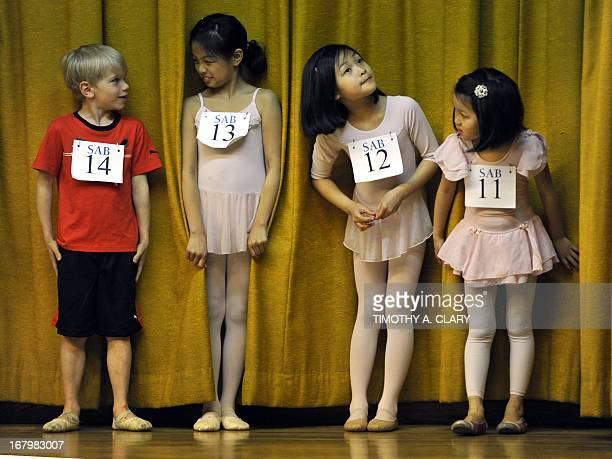 Young ballet dancers Daniel Chauvin Renee Ng Bridgette Ng and Natalie Ng stand together as boys and girls ages 6 to 10 try out for The School of...