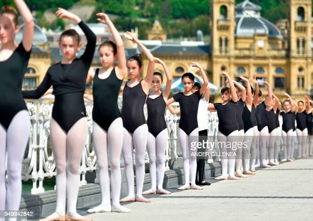 Young ballet dancers take part in a classic dance exhibition gathering some 1400 participants to celebrate the Month of The Dance in La Concha bay in...
