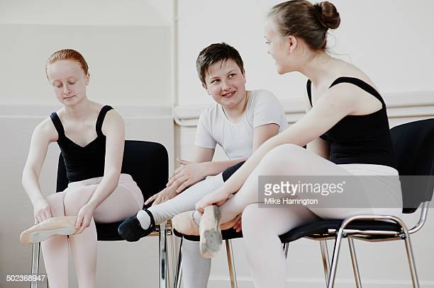 Young ballet dancers talking at practise.