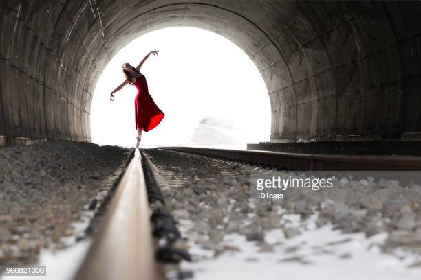 young ballet dancing on the rail in a tunnel in winter season. - soul train dancers stock photos and pictures