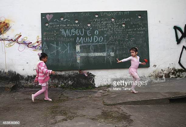 Young ballet students play outside before their ballet class begins at the Museu da Mare in the occupied Complexo da Mare one of the largest favela...