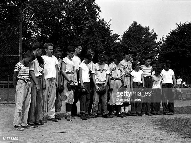 Young ballplayers pause to bow their heads in memory of their idol Babe Ruth on August 18 1948 in Newark New Jersey Babe Ruth passed away on August...