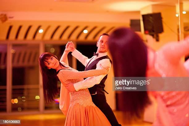 Young ballroom dancers practising in mirror