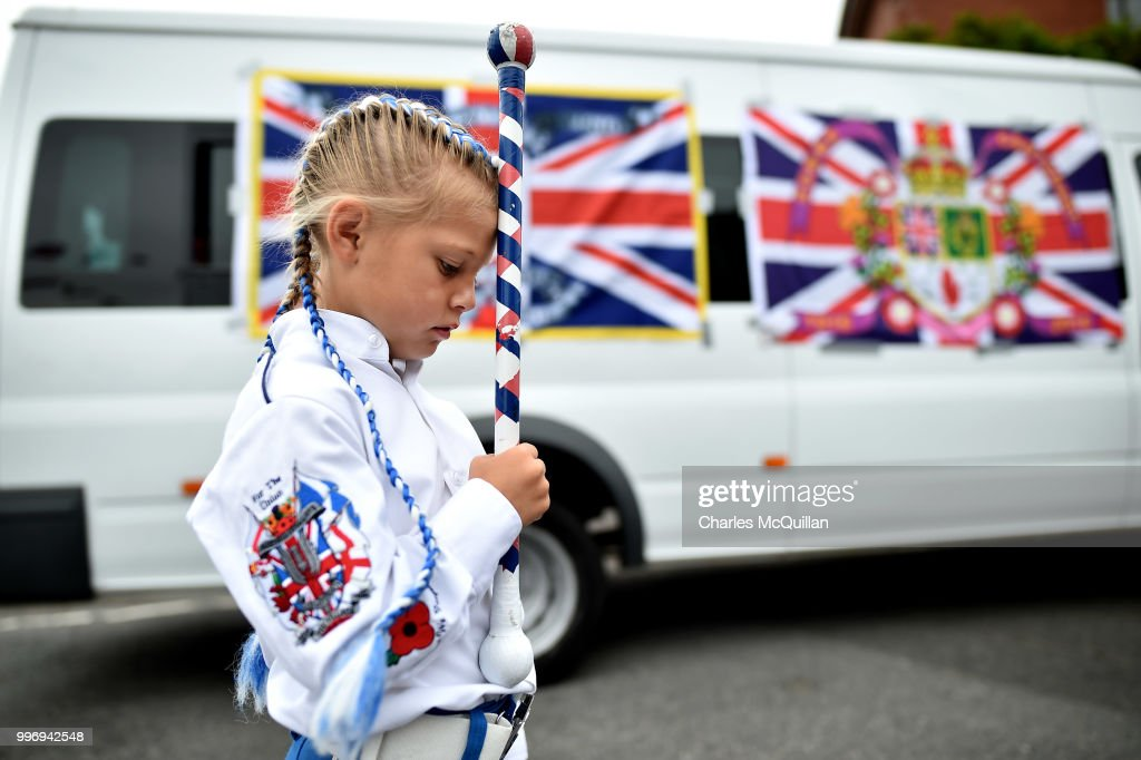 A young band member prepares before the start of the annual 12th of July Orange march and demonstration takes place on July 12, 2018 in Belfast, Northern Ireland. The marches across the province celebrate King William of Orange's victory over the Catholic King James at the Battle of the Boyne in 1690.