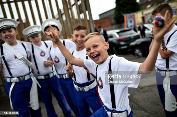 Young band members show off and pose as the annual 12th of July Orange march and demonstration takes place on July 12 2018 in Belfast Northern...