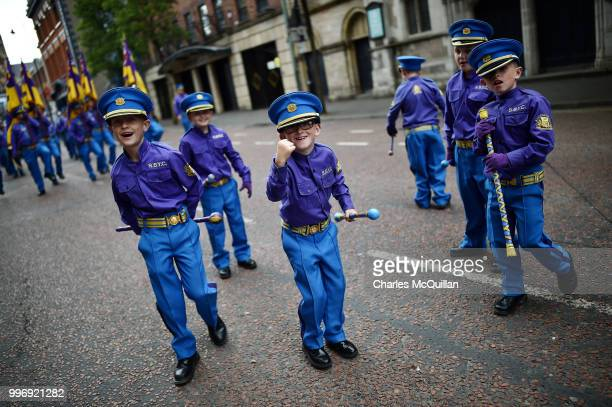 Young band members throw their batons in the air as the annual 12th of July Orange march and demonstration taking place on July 12 2018 in Belfast...