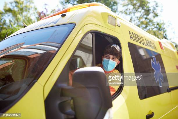 young barcelona ambulance driver wearing protective mask - ambulance stock pictures, royalty-free photos & images